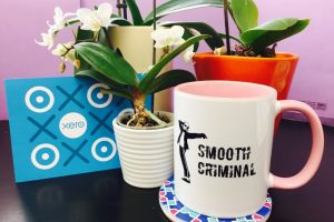 smooth criminal cup and postcard with flowers in background